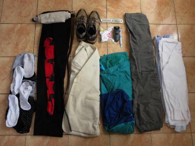 TRAVEL CHECKLIST FOR THE TROPICS: Roll up clothes for compact packing.